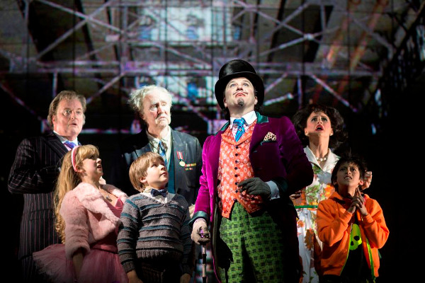 Douglas Hodge as Willy Wonka with Jack Costello as Charlie and cast members of Charlie and the Chocolate Factory