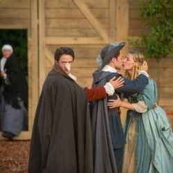 Cyrano (Edward Harrison) aids the romance of Christian (Owen Findlay) and Roxane (Sally Scott) in Cyrano De Bergerac at the Grosvenor Park in Chester.